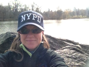 On a run through Central Park in NYC feeling empowered with my NYPD hat on